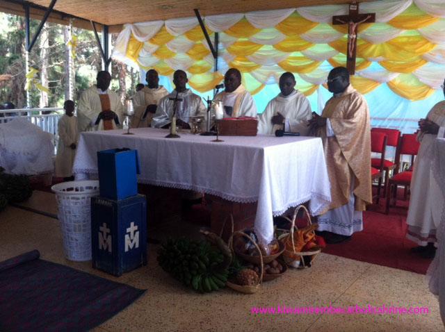 Archibishop delegate Msgr Kasibante Charles Leading mass